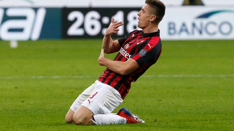 <p>               AC Milan's Krzysztof Piatek celebrates after scoring his side's second goal during an Italian Cup quarter-final soccer match between AC Milan and Napoli at the San Siro stadium, in Milan, Italy, Tuesday, Jan. 29, 2019. (AP Photo/Antonio Calanni)             </p>