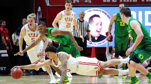 <p>               Utah forward Timmy Allen (20) dives in front of Oregon forward Louis King (2) to grab the ball during the second half of an NCAA college basketball game Thursday, Jan. 31, 2019, in Salt Lake City. Oregon won 78-72. (AP Photo/Chris Nicoll)             </p>