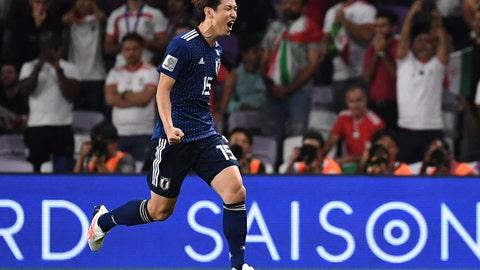 <p>               Japan's forward Yuya Osako, runs as he celebrates his penalty goal during the AFC Asian Cup semifinal soccer match between Iran and Japan at Hazza Bin Zayed Stadium in Al Ain, United Arab Emirates, Monday, Jan. 28, 2015. (AP Photo/Hassan Ammar)             </p>