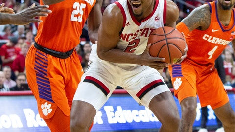 <p>               North Carolina State's Torin Dorn (2) gathers the ball as Clemson's Aamir Simms (25) defends during the first half of an NCAA college basketball game in Raleigh, N.C., Saturday, Jan. 26, 2019. (AP Photo/Ben McKeown)             </p>