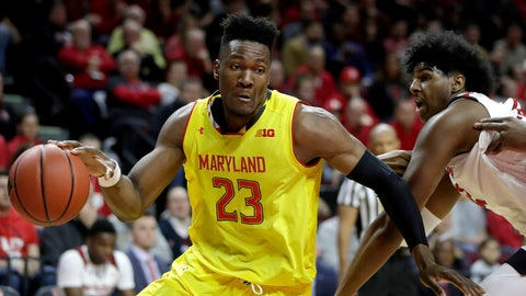 <p>               Maryland forward Bruno Fernando (23) drives to the basket as Rutgers center Myles Johnson, right, tries to defend during the first half of an NCAA college basketball game, Saturday, Jan. 5, 2019, in Piscataway, N.J. (AP Photo/Julio Cortez)             </p>