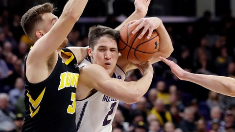 <p>               Northwestern guard Ryan Greer, center, drives to the basket against Iowa guard Jordan Bohannon, left, and forward Nicholas Baer during the second half of an NCAA college basketball game Wednesday, Jan. 9, 2019, in Evanston, Ill. Iowa won 73-63. (AP Photo/Nam Y. Huh)             </p>