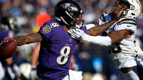 <p>               Baltimore Ravens quarterback Lamar Jackson (8) tries to break free from Los Angeles Chargers free safety Derwin James in the first half of an NFL wild card playoff football game, Sunday, Jan. 6, 2019, in Baltimore. (AP Photo/Nick Wass)             </p>