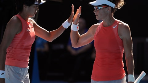 <p>               China's Zhang Shuai, left, and Australia's Samantha Stosur celebrate a point win over France's Kristina Mladenovic and Hungary's Timea Babos during the women's doubles final at the Australian Open tennis championships in Melbourne, Australia, Friday, Jan. 25, 2019. (AP Photo/Mark Schiefelbein)             </p>