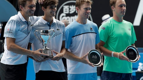 <p>               France's Nicolas Mahut , left, compatriot Pierre-Hugues Herbet pose with their trophy after defeating Finland's Henri Kontinen, right, and Australia's John Peers in the men's doubles final at the Australian Open tennis championships in Melbourne, Australia, Sunday, Jan. 27, 2019. (AP Photo/Aaron Favila)             </p>