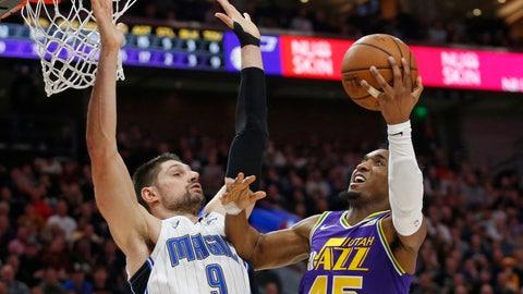 <p>               Utah Jazz guard Donovan Mitchell (45) goes to the basket as Orlando Magic center Nikola Vucevic (9) defends during the second half of an NBA basketball game Wednesday, Jan. 9, 2019, in Salt Lake City. (AP Photo/Rick Bowmer)             </p>