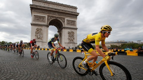 <p>               Tour de France winner Geraint Thomas, of Britain, wearing the overall leader's yellow jersey, passes the Arc de Triomphe on July 29, 2018, during the twenty-first stage of the 116-kilometer (72.1-mile) Tour de France cycling race from Houilles to the Champs-Elysees in Paris. (AP Photo/Christophe Ena)             </p>