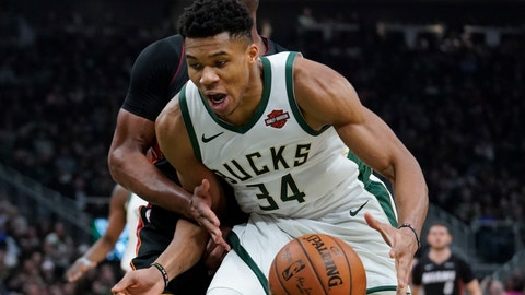 <p>               Miami Heat's Dwyane Wade knocks the ball from Milwaukee Bucks' Giannis Antetokounmpo during the second half of an NBA basketball game Tuesday, Jan. 15, 2019, in Milwaukee. (AP Photo/Morry Gash)             </p>