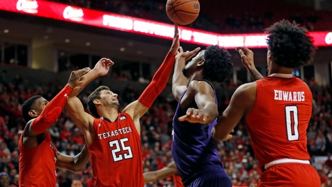 <p>               Texas Tech's Davide Moretti (25) and TCU's Ruseel Barlow (34) try to rebound the ball during the first half of an NCAA college basketball game Monday, Jan. 28, 2019, in Lubbock, Texas. (AP Photo/Brad Tollefson)             </p>