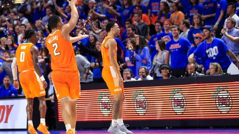 <p>               Tennessee players Jordan Bone (0) and Grant Williams (2) and Lamonte Turner (1) celebrate in front of Florida fans an NCAA college basketball game Saturday, Jan. 12, 2019, in Gainesville, Fla. Tennessee won 78-67 (AP Photo/Matt Stamey)             </p>