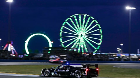 <p>               Fernando Alonso drives his Cadillac DPi during the evening hours of the IMSA 24-hour race at Daytona International Speedway, Saturday, Jan. 26, 2019, in Daytona Beach, Fla. (AP Photo/John Raoux)             </p>