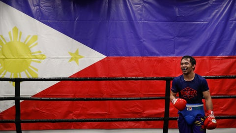<p>               Standing in front of a large Filipino flag, boxer Manny Pacquiao smiles while training at the Wild Card Boxing Club Monday, Jan. 14, 2019, in Los Angeles. The Filipino legend is in the winter of his career, gearing up for what could be one big last fight. Saturday's bout versus Broner isn't it, but Pacquiao trains with the knowledge that a second megafight against Floyd Mayweather could possibly be just months away if all goes well. (AP Photo/Jae C. Hong)             </p>
