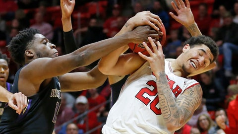 <p>               Washington forward Noah Dickerson, left, and Utah forward Timmy Allen (20) vie for a rebound during the second half of an NCAA college basketball game Thursday, Jan. 10, 2019, in Salt Lake City. (AP Photo/Rick Bowmer)             </p>