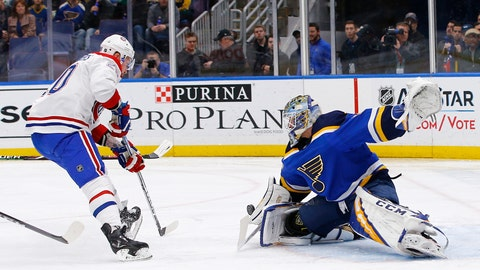 <p>               St. Louis Blues goaltender Jordan Binnington stops a shot by Montreal Canadiens' Nicolas Deslauriers, left, during the first period of an NHL hockey game Thursday, Jan. 10, 2019, in St. Louis. (AP Photo/Billy Hurst)             </p>