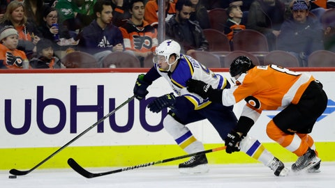 <p>               St. Louis Blues' Vladimir Tarasenko, left, tries to slips past Philadelphia Flyers' Robert Hagg during the first period of an NHL hockey game, Monday, Jan. 7, 2019, in Philadelphia. (AP Photo/Matt Slocum)             </p>