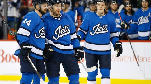 <p>               Winnipeg Jets' Josh Morrissey (44), Bryan Little (18) and Sami Niku (83) celebrate Little's goal against the Detroit Red Wings during the second period of an NHL hockey game Friday, Jan. 11, 2019, in Winnipeg, Manitoba. (John Woods/The Canadian Press via AP)             </p>