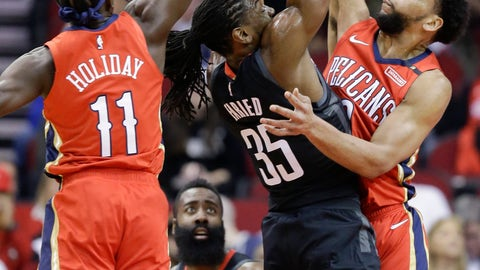 <p>               Houston Rockets forward Kenneth Faried, center, shoots as New Orleans Pelicans guard Jrue Holiday (11) and center Jahlil Okafor defend during the first half of an NBA basketball game Tuesday, Jan. 29, 2019, in Houston. (AP Photo/Eric Christian Smith)             </p>