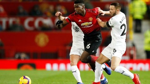 <p>               Manchester United's Paul Pogba struggles to pass Burnley's Phil Bardsley, right, during their English Premier League soccer match at Old Trafford in Manchester, England, Tuesday Jan. 29, 2019. (Martin Rickett/PA via AP)             </p>