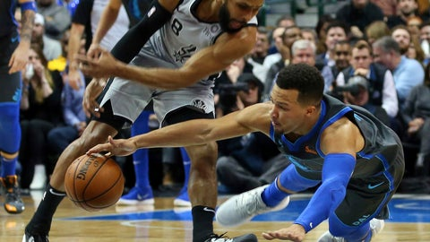 <p>               San Antonio Spurs guard Patty Mills (8) and Dallas Mavericks guard Jalen Brunson (13) chase a loose ball in the first half of an NBA basketball game, Wednesday, Jan. 16, 2019, in Dallas. (AP Photo/Richard W. Rodriguez)             </p>