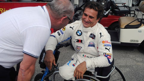 <p>               Alex Zanardi, right, speaks with an unidentified person in the garage at Daytona International Speedway in Daytona Beach, Fla., Friday, Jan. 4, 2018, where he is preparing for the Rolex 24, an endurance race at Daytona in late January. Zanardi is still racing 17 years after both his legs were severed in a crash. The Italian is now behind the wheel of a BMW that has been customized for Zanardi to race without his prosthetic legs. (AP Photo/Mark Long)             </p>
