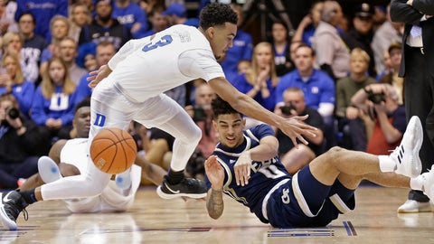 <p>               Duke's Tre Jones (3) reaches in as Georgia Tech's Michael Devoe (0) passes from the floor during the first half of an NCAA college basketball game in Durham, N.C., Saturday, Jan. 26, 2019. (AP Photo/Gerry Broome)             </p>