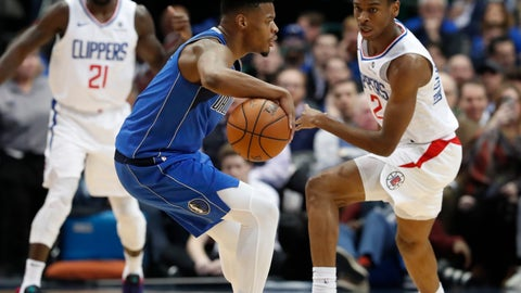 <p>               Dallas Mavericks guard Dennis Smith Jr. (1) dribbles against LA Clippers guard Shai Gilgeous-Alexander (2) during the first half of an NBA basketball game in Dallas, Tuesday, Jan. 22, 2019. (AP Photo/LM Otero)             </p>