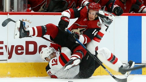 <p>               Arizona Coyotes right wing Richard Panik (14) flips over New Jersey Devils defenseman Ben Lovejoy (12) as Panik passes the puck during the first period of an NHL hockey game Friday, Jan. 4, 2019, in Glendale, Ariz. (AP Photo/Ross D. Franklin)             </p>