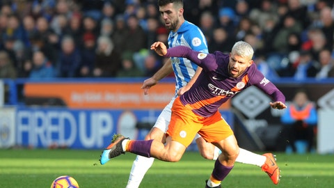 <p>               Manchester City's Sergio Aguero, right, is tackled by Huddersfield's Tommy Smith during the English Premier League soccer match between Huddersfield Town and Manchester City at John Smith's stadium in Huddersfield, England, Sunday, Jan. 20, 2019. (AP Photo/Rui Vieira)             </p>
