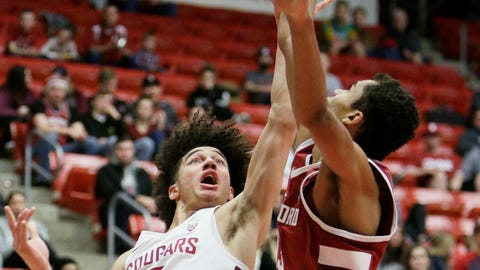 <p>               Washington State forward CJ Elleby, left, shoots while defended by Stanford forward Oscar da Silva during the second half of an NCAA college basketball game in Pullman, Wash., Saturday, Jan. 19, 2019. Stanford won 78-66. (AP Photo/Young Kwak)             </p>