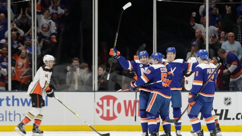 <p>               New York Islanders' Cal Clutterbuck, second from left, celebrates with teammates after scoring a goal as Anaheim Ducks' Cam Fowler (4) skates past during the first period of an NHL hockey game Sunday, Jan. 20, 2019, in Uniondale, N.Y. (AP Photo/Frank Franklin II)             </p>