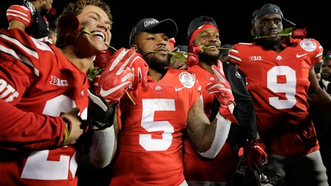 <p>               Ohio State players celebrate after a 28-23 win over Washington in the Rose Bowl NCAA college football game Tuesday, Jan. 1, 2019, in Pasadena, Calif.(AP Photo/Jae C. Hong)             </p>