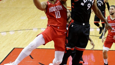 <p>               Houston Rockets guard Eric Gordon (10) drives to the basket as Toronto Raptors center Serge Ibaka (9) defends during the first half of an NBA basketball game, Friday, Jan. 25, 2019, in Houston. (AP Photo/Eric Christian Smith)             </p>