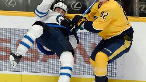 <p>               Nashville Predators center Ryan Johansen (92) checks Winnipeg Jets defenseman Sami Niku (83), of Finland, into the boards during the first period of an NHL hockey game Thursday, Jan. 17, 2019, in Nashville, Tenn. (AP Photo/Mark Zaleski)             </p>