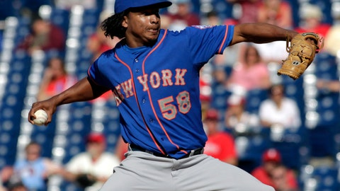 <p>               FILE - In this June 1, 2014, file photo, New York Mets relief pitcher Jenrry Mejia (58) throws against the Philadelphia Phillies in the 11th inning of a baseball game in Philadelphia. Mejia, allowed back into baseball after a lifetime ban caused by three positive drug tests, has agreed to a minor league contract with the Boston Red Sox. (AP Photo/H. Rumph Jr., File)             </p>