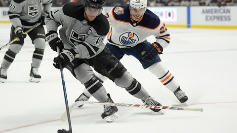 <p>               Los Angeles Kings center Anze Kopitar, center, takes the puck as Edmonton Oilers right wing Tobias Rieder loses his stick during the second period of an NHL hockey game, Saturday, Jan. 5, 2019, in Los Angeles. (AP Photo/Mark J. Terrill)             </p>