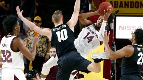 <p>               Arizona State forward Kimani Lawrence (14) tries to pass the ball under the basket around the defense of Colorado's Alexander Strating (10) during the first half of an NCAA college basketball game, Saturday, Jan. 5, 2019, in Tempe, Ariz. (AP Photo/Ralph Freso)             </p>
