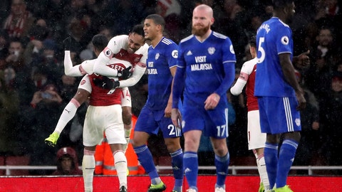 <p>               Arsenal's Pierre-Emerick Aubameyang, top left, celebrates scoring his side's first goal of the game from the penalty spot against Cardiff City during their English Premier League soccer match at the Emirates Stadium in London, Tuesday Jan. 29, 2019. (Nick Potts/PA via AP)             </p>