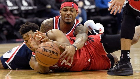 <p>               Washington Wizards guard Bradley Beal, top, battles for the ball against Toronto Raptors guard Kyle Lowry during the second half of an NBA basketball game, Sunday, Jan. 13, 2019, in Washington. (AP Photo/Nick Wass)             </p>