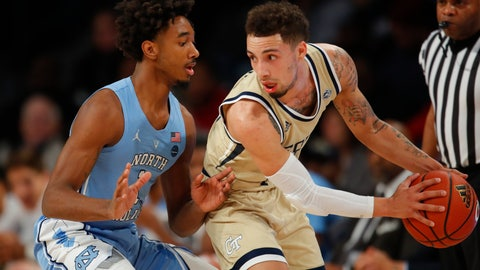 <p>               Georgia Tech  guard Jose Alvarado (10) looks to pass as he is defended by North Carolina  guard Leaky Black (1) during the first half of an NCAA college basketball game in Atlanta, Tuesday, Jan. 29, 2019. (AP Photo/Todd Kirkland)             </p>