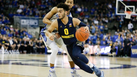 <p>               Marquette's Markus Howard (0) tries to get past Creighton's DavionMintz during the first half of an NCAA college basketball game in Omaha, Neb., Wednesday, Jan. 9, 2019. (AP Photo/Nati Harnik)             </p>