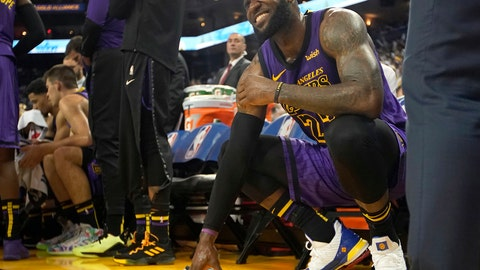 <p>               FILE -In this Dec. 25, 2018, file photo, Los Angeles Lakers forward LeBron James (23) reacts after straining his left groin during the second half of an NBA basketball game against the Golden State Warriors in Oakland, Calif. The Lakers say James likely will miss at least three more games after being cleared to increase his on-court activity in his comeback from the groin injury. James was evaluated by the Lakers' medical staff Thursday, Jan. 10, 2019. (AP Photo/Tony Avelar, File)             </p>