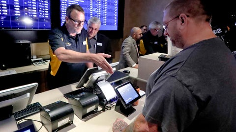 <p>               FILE - In this Dec. 13, 2018, file photo, Ryan Martin, right, looks over his wager at Rivers Casino, as the new, temporary sports betting area opened in Pittsburgh. Pending Pennsylvania Gaming Control Board approval, regular operations are scheduled to begin Saturday, Dec. 15. Marton made several wagers, including placing a $100 bet on the Pittsburgh Steelers to win the Super Bowl. Anyone willing to wager that the high-scoring Patriots or Rams will get shut out in the Super Bowl can count on a big payday if that unlikely scenario occurs. Prop bets aren't a big moneymaker for sports books during the season, but they pick up popularity as the nation is intensely focused on a single game. (AP Photo/Keith Srakocic. File)             </p>
