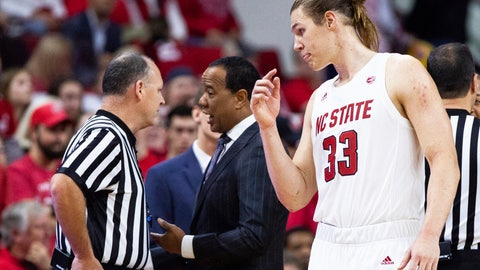<p>               North Carolina State's Wyatt Walker (33) listens as coach Kevin Keatts, center, speaks with an official during the first half of an NCAA college basketball game against Pittsburgh in Raleigh, N.C., Saturday, Jan. 12, 2019. Walker was ejected after being called for a flagrant foul. (AP Photo/Ben McKeown_             </p>