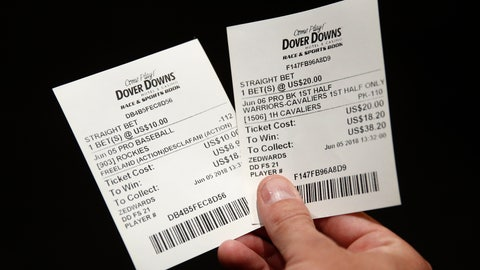 <p>               FILE - In this June 5, 2018, file photo, John Celatka displays a pair of receipts for bets he placed on an MLB baseball game and an NBA basketball game, inside the Race and Sports Book at Dover Downs Hotel and Casino in Dover, Del. A new, gambling-focused telecast of Washington Wizards games is just the appetizer to what the team and its TV partner hope will be a more substantial main course: giving fans the ability to place bets in real time while watching games at home. Whether that idea comes to fruition will depend on laws in the states where Wizards games are shown on the regional network NBC Sports Washington. But the concept shows how legal sports betting continues to change the way sports are presented to the public. (AP Photo/Patrick Semansky, File)             </p>