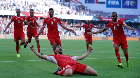 <p>               Jordan's defender Anas Bani Yaseen, front, celebrates with teammates after scoring the opening goal during the AFC Asian Cup group B soccer match between Australia and Jordan at Hazza bin Zayed stadium in Al Ain, United Arab Emirates, Sunday, Jan. 6, 2019. (AP Photo/Hassan Ammar)             </p>