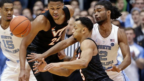 <p>               North Carolina's Coby White (2) chases the ball with Virginia Tech's Kerry Blackshear Jr. (24) and Justin Robinson (5) during the first half of an NCAA college basketball game in Chapel Hill, N.C., Monday, Jan. 21, 2019. (AP Photo/Gerry Broome)             </p>