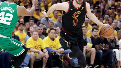 """<p>               FILE - In this May 21, 2018, file photo, Cleveland Cavaliers' Kevin Love (0) drives around Boston Celtics' Al Horford (42) during the first half of Game 4 of the NBA basketball Eastern Conference finals in Cleveland.  Love has been cleared to begin """"select basketball activities"""" following foot surgery. Love played in just four games this season before undergoing surgery on Nov. 2 to repair an injury sustained during Cleveland's exhibition opener. (AP Photo/Tony Dejak, File)             </p>"""