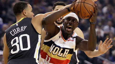 <p>               New Orleans Pelicans' Jrue Holiday, right, looks to shoot against Golden State Warriors' Stephen Curry (30) during the first half of an NBA basketball game Wednesday, Jan. 16, 2019, in Oakland, Calif. (AP Photo/Ben Margot)             </p>