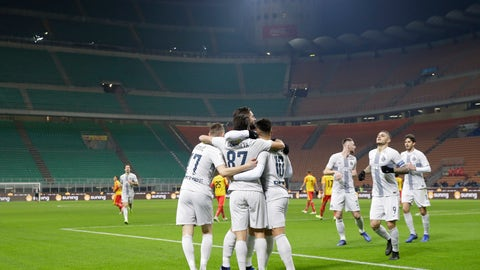 <p>               Inter Milan's Antonio Candreva, second from left, celebrates with teammates after scoring his team's second goal during an Italian Cup second round soccer match between Inter Milan and Benevento, at the San Siro stadium in Milan, Italy, Sunday, Jan. 13, 2019. (AP Photo/Luca Bruno)             </p>