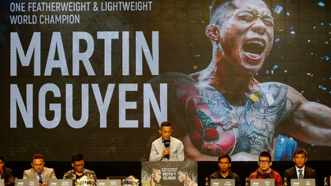 <p>               FILE - In this July 24, 2018, file photo, reigning ONE featherweight and lightweight world champion Martin Nguyen  addresses reporters during a news conference for the ONE Championship mixed martial arts event in Pasay city, south of Manila, Philippines. One Championship, the MMA organization out of Asia, is going global in 2019 and it's making the kind of moves that shows it plans to become a player in combat sports. (AP Photo/Bullit Marquez, File)             </p>